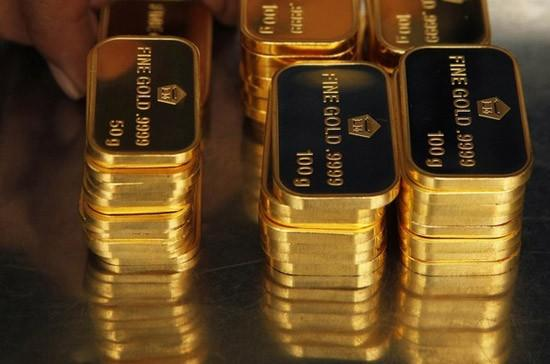 283231-gold-prices-fall-more-than-1-percent-as-fed-disappoints